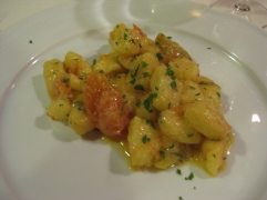 Our gnocchi with tomatoes sauteed in garlic infused olive oil carmelized onions and fresh rosemary